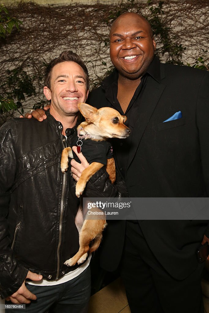 Actors David Faustino (L) and Windell Middlebrooks pose with a dog wearing Lyric Culture for PetSmart at Much Love Animal Rescue's makeovers for mutts at Peninsula Hotel on March 14, 2013 in Beverly Hills, California.