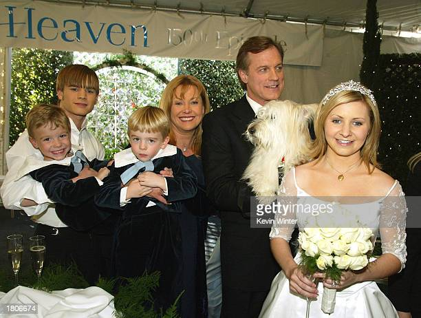 Actors David Gallagher twins Lorenzo and Nikolas Brino Catherine Hicks Stephen Collins and Beverley Mitchell pose at a reception to celebrate 150...