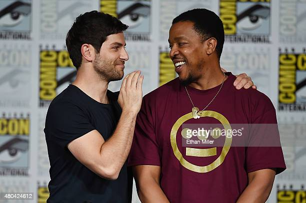 Actors David Giuntoli and Russell Hornsby attend the 'Grimm' season five panel during ComicCon International 2015 at the San Diego Convention Center...