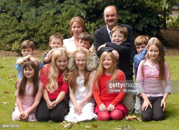Actors David Haig and Linzi Hateley who will play 'George and Winifred Banks' pose with the children chosen to play their children Jane and Michael...