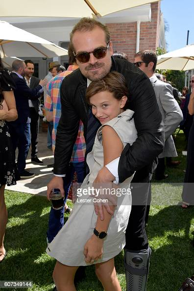Actors David Harbour and Millie Bobby Brown at the ICM Partners PreEmmy Brunch on September 17 2016 in Santa Monica California
