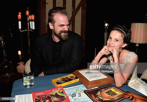 Actors David Harbour and Millie Brown attend the after party for the premiere of Netflix's 'Stranger Things' at Mack Sennett Studios on July 11 2016...