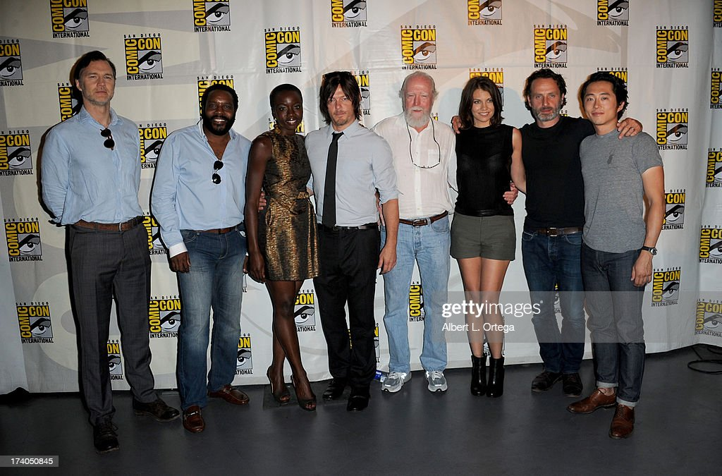 Actors David Morrissey, Chad L. Coleman, Danai Gurira, Norman Reedus, Scott Wilson, Lauren Cohan, Andrew Lincoln and Steven Yeun speak onstage at AMC's 'The Walking Dead' panel during Comic-Con International 2013 at San Diego Convention Center on July 19, 2013 in San Diego, California.