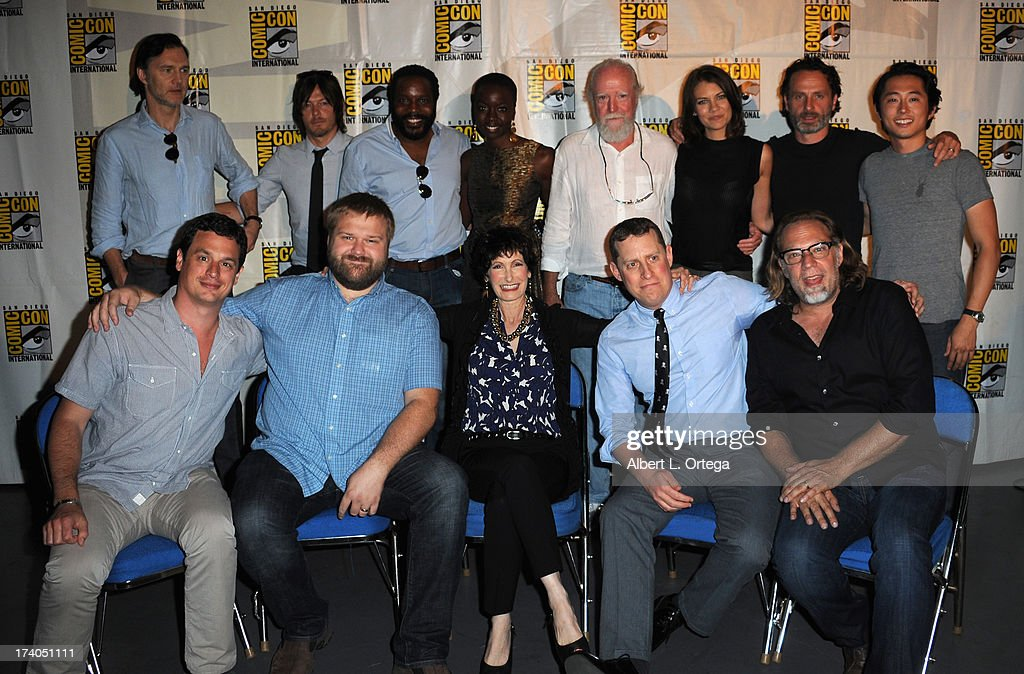 Actors David Morrissey, Norman Reedus, Chad L. Coleman, Danai Gurira, Scott Wilson, Lauren Cohan, Andrew Lincoln and Steven Yeun, producer David Alpert, writer Robert Kirkman, producers Gale Anne Hurd, Scott Gimple and director / producer Gregory Nicotero speak onstage at AMC's 'The Walking Dead' panel during Comic-Con International 2013 at San Diego Convention Center on July 19, 2013 in San Diego, California.