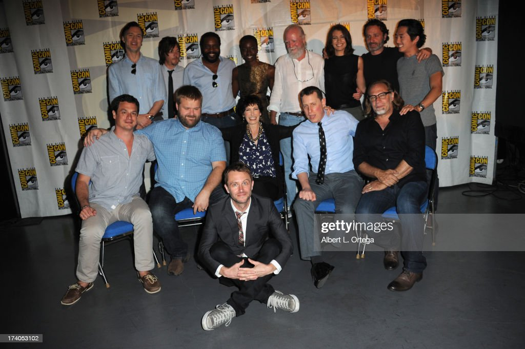 Actors David Morrissey, Norman Reedus, Chad L. Coleman, Danai Gurira, Scott Wilson, Lauren Cohan, Andrew Lincoln and Steven Yeun; (Front row) Producer David Alpert, writer Robert Kirkman, producers Gale Anne Hurd and Scott Gimple, director/producer Greg Nicotero and producer Kenneth Requa (front center) onstage at AMC's 'The Walking Dead' panel during Comic-Con International 2013 at San Diego Convention Center on July 19, 2013 in San Diego, California.