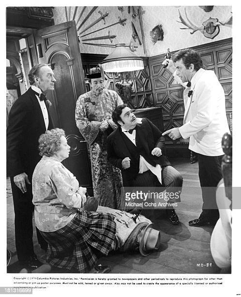 Actors David Nivenactress Elsa Lanchester actor Peter Sellers James Coco and Peter Falk on the set of Columbia Pictures movie 'Murder by Death' in...