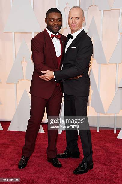 Actors David Oyelowo and Michael Keaton attend the 87th Annual Academy Awards at Hollywood Highland Center on February 22 2015 in Hollywood California