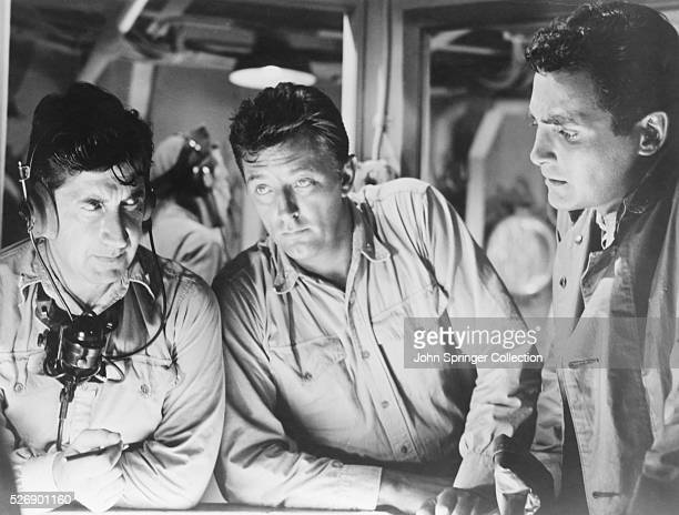 Actors David Post Robert Mitchum and David Hedison in a submarine scene from the 1957 World War II film The Enemy Below Post plays a sonar operator...