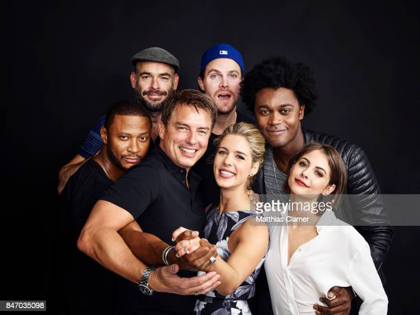 Actors David Ramsey Paul Blackthorne Stephen Amell Echo Kellum Willa Holland Emily Bett Rickards and John Barrowman from 'Arrow' are photographed for...