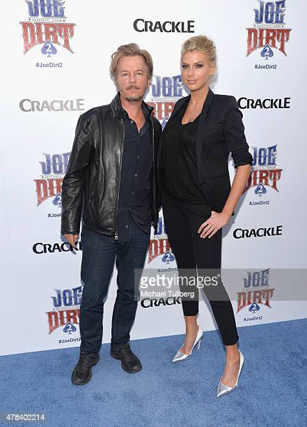 Actors David Spade and Charlotte McKinney attend the premiere of Crackle's new film 'Joe Dirt 2 Beautiful Loser' at Sony Studios on June 24 2015 in...