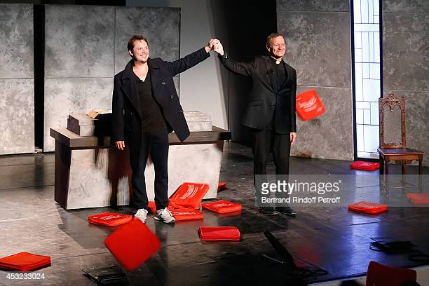 Actors Davy Sardou and Francis Huster during the traditional throw of cushions at the final of 'L'Affrontement' play during the 30th Ramatuelle...