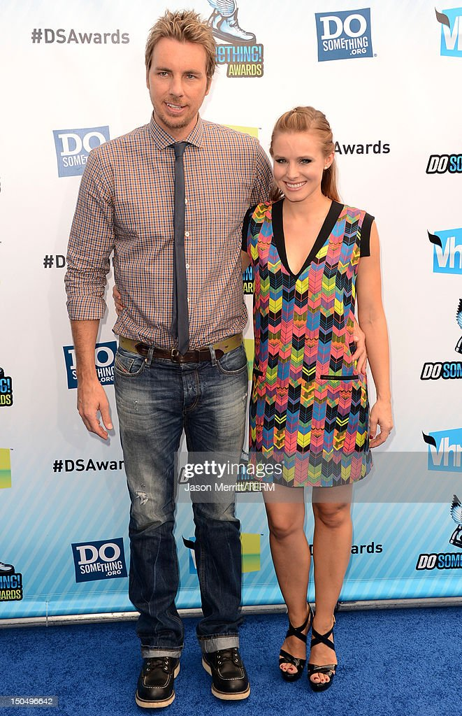 Actors Dax Shepard and Kristen Bell arrive at the 2012 Do Something Awards at Barker Hangar on August 19, 2012 in Santa Monica, California.