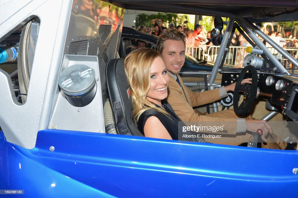 Actors <a gi-track='captionPersonalityLinkClicked' href=/galleries/search?phrase=Dax+Shepard&family=editorial&specificpeople=810830 ng-click='$event.stopPropagation()'>Dax Shepard</a> and <a gi-track='captionPersonalityLinkClicked' href=/galleries/search?phrase=Kristen+Bell&family=editorial&specificpeople=194764 ng-click='$event.stopPropagation()'>Kristen Bell</a> (L) arrive to the premiere of Open Road Films' 'Hit and Run' on August 14, 2012 in Los Angeles, California.