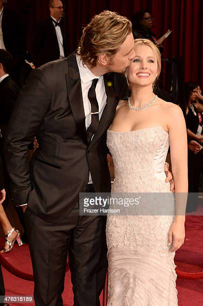 Actors Dax Shepard and Kristen Bell attends the Oscars held at Hollywood Highland Center on March 2 2014 in Hollywood California