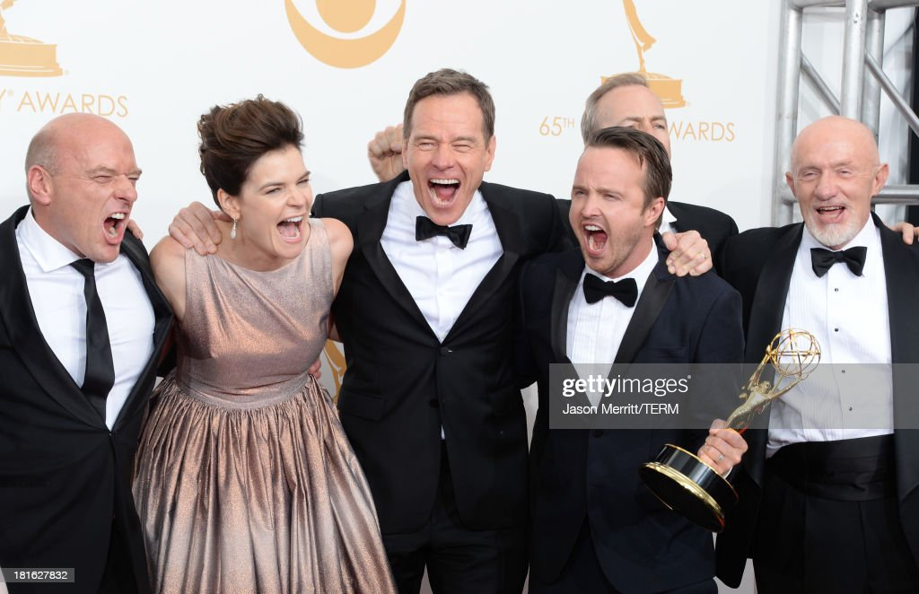 Actors <a gi-track='captionPersonalityLinkClicked' href=/galleries/search?phrase=Dean+Norris&family=editorial&specificpeople=4195761 ng-click='$event.stopPropagation()'>Dean Norris</a>, <a gi-track='captionPersonalityLinkClicked' href=/galleries/search?phrase=Betsy+Brandt&family=editorial&specificpeople=4819893 ng-click='$event.stopPropagation()'>Betsy Brandt</a>, <a gi-track='captionPersonalityLinkClicked' href=/galleries/search?phrase=Bryan+Cranston&family=editorial&specificpeople=217768 ng-click='$event.stopPropagation()'>Bryan Cranston</a>, <a gi-track='captionPersonalityLinkClicked' href=/galleries/search?phrase=Aaron+Paul+-+Actor&family=editorial&specificpeople=693211 ng-click='$event.stopPropagation()'>Aaron Paul</a> and Jonathan Banks, winners of Outstanding Drama Series for 'Breaking Bad,' pose in the press room during the 65th Annual Primetime Emmy Awards held at Nokia Theatre L.A. Live on September 22, 2013 in Los Angeles, California.