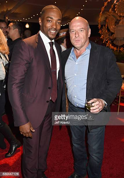 Actors Dean Norris right and Anthony Mackie attend the afterparty of the Premiere Of HBO's 'All The Way' on May 10 2016 in Hollywood California
