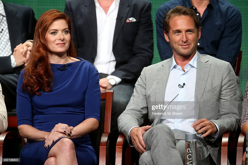 Actors Debra Messing and Josh Lucas speak onstage at the 'The Mysteries of Laura' panel during the NBCUniversal portion of the 2014 Summer Television Critics Association at The Beverly Hilton Hotel on July 13, 2014 in Beverly Hills, California.