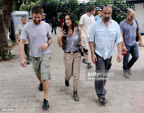 Actors Demi Moore Gerard Butler and Dr Reza Nabavian visit a camp for internally displaced persons managed by actor Sean Penn and his JenkinsPenn...