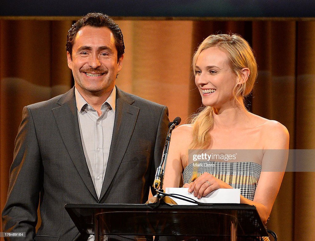 Actors Demian Bichir and Diane Kruger speak onstage at the Hollywood Foreign Press Association's 2013 Installation Luncheon at The Beverly Hilton Hotel on August 13, 2013 in Beverly Hills, California.