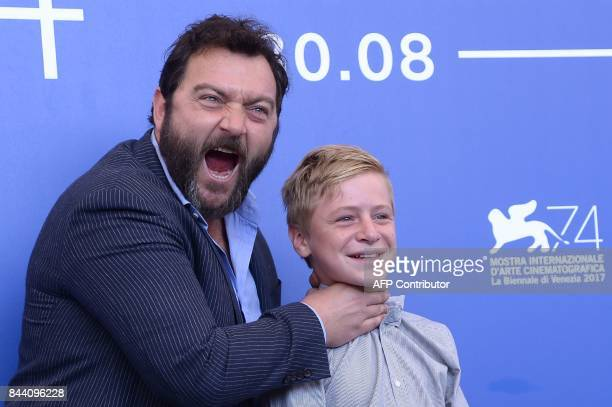 Actors Denis Menochet and Thomas Gioria attend the photocall of the movie 'Jusqu'à la Garde' presented in competition at the 74th Venice Film...