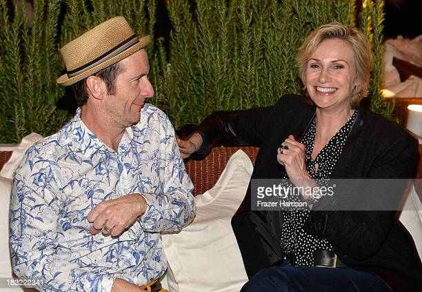 Actors Denis O'Hare and Jane Lynch attend the Premiere Of FX's 'American Horror Story Coven' after party at Fig Olive Melrose Place on October 5 2013...