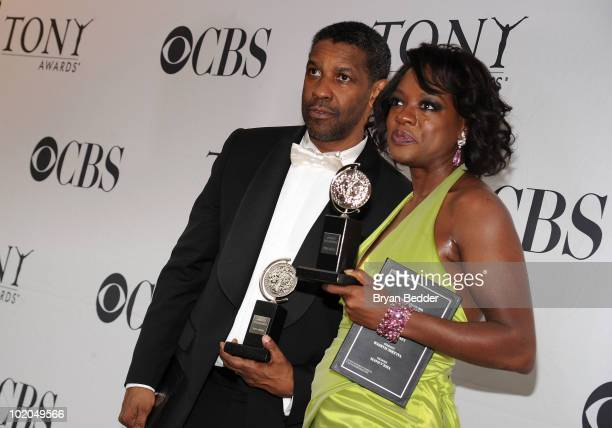 Actors Denzel Washington and Viola Davis poses with their awards at the 64th Annual Tony Awards at The Sports Club/LA on June 13 2010 in New York City