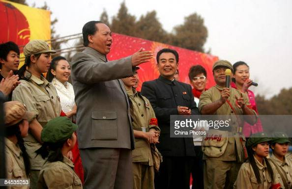 Actors depicting the late Chinese leaders Mao Zedong and Zhou Enlai perform at the Ditan Temple Fair during Chinese New Year celebrations on January...