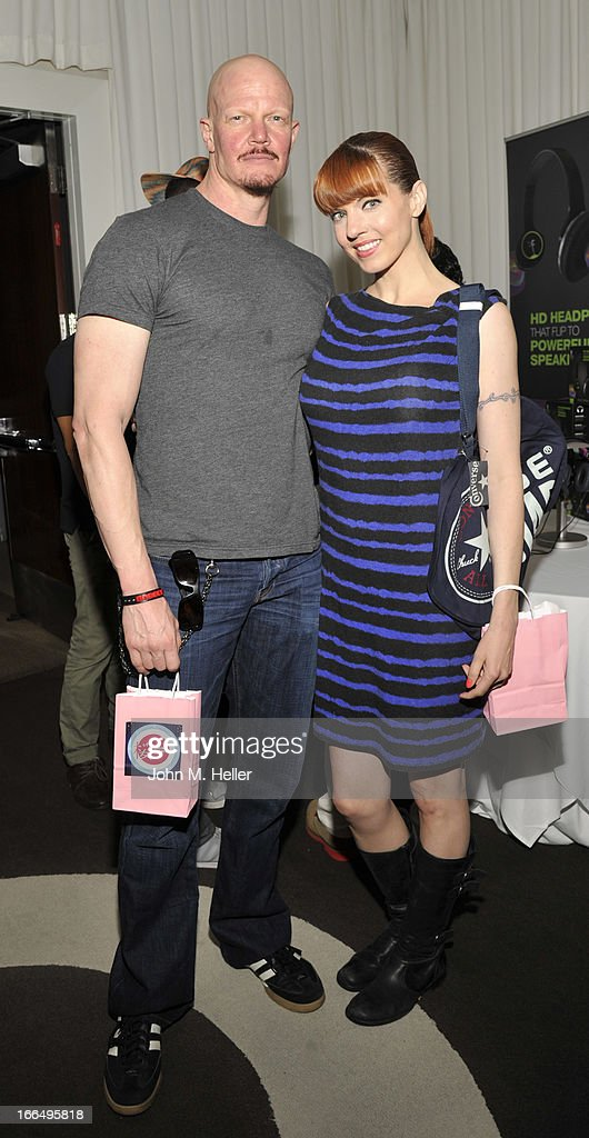 Actors Derek Mears and Jenny Brezinski attend the Flips Audio MTV Awards Secret Room gifting suite at the SLS Hotel on April 12, 2013 in Beverly Hills, California.