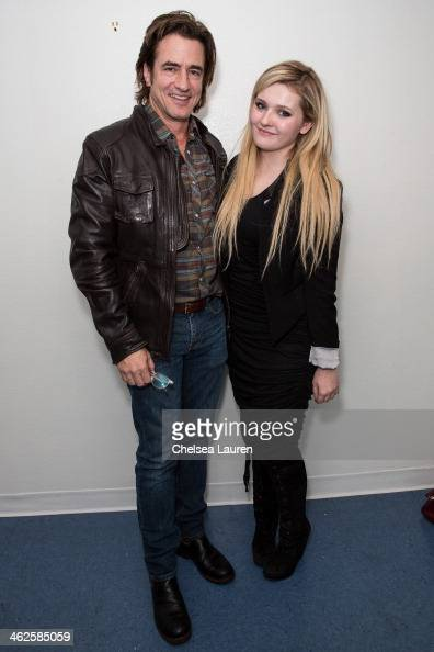 Actors Dermot Mulroney and Abigail Breslin pose backstage at the 'August Osage County' SAG Awards special screening at Harmony Gold Theatre on...