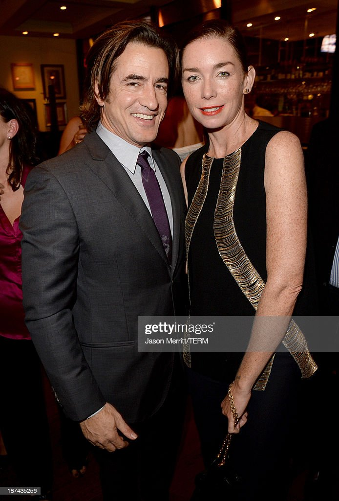 Actors Dermot Mulroney (L) and Julianne Nicholson attend The Weinstein Company Presents 'August: Osage County' Gala Screening Cocktail Reception during AFI FEST 2013 presented by Audi at TCL Chinese Theatre on November 8, 2013 in Hollywood, California.