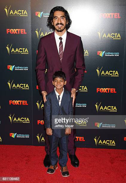 Actors Dev Patel and Sunny Pawar arrive at the 6th AACTA International Awards at Avalon Hollywood on January 6 2017 in Los Angeles California