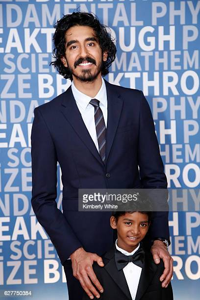 Actors Dev Patel and Sunny Pawar attend the 2017 Breakthrough Prize at NASA Ames Research Center on December 4 2016 in Mountain View California