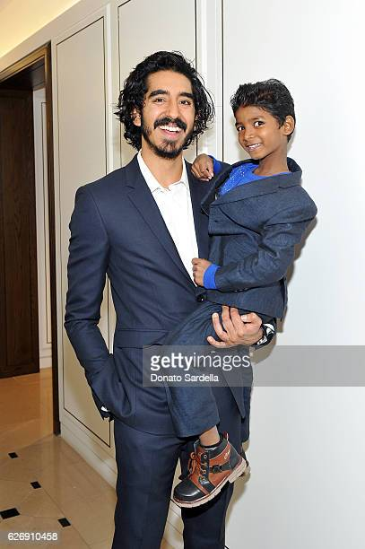 Actors Dev Patel and Sunny Pawar wearing Burberry at Burberry and The Weinstein Company honour Dev Patel and his performance in Lion on November 30...