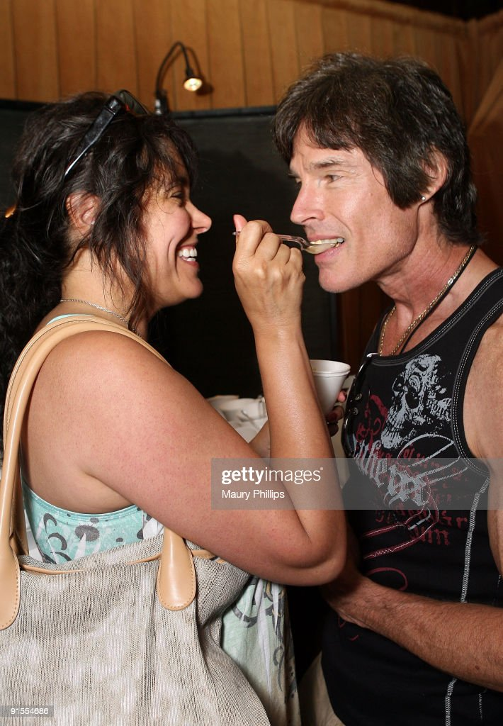 Actors Devin Devasquez and <a gi-track='captionPersonalityLinkClicked' href=/galleries/search?phrase=Ronn+Moss&family=editorial&specificpeople=220936 ng-click='$event.stopPropagation()'>Ronn Moss</a> pose in the Daytime Emmy official gift lounge produced by On 3 Productions held at The Orpheum Theatre on August 29, 2009 in Los Angeles, California.