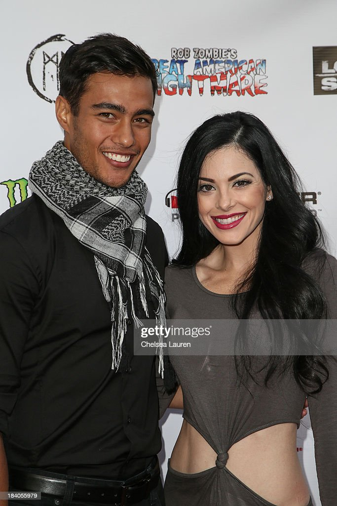 Actors Devon Spence (L) and Olivia Alexander attend Rob Zombie's Great American Nightmare VIP opening night party at Pomona FEARplex on October 10, 2013 in Pomona, California.