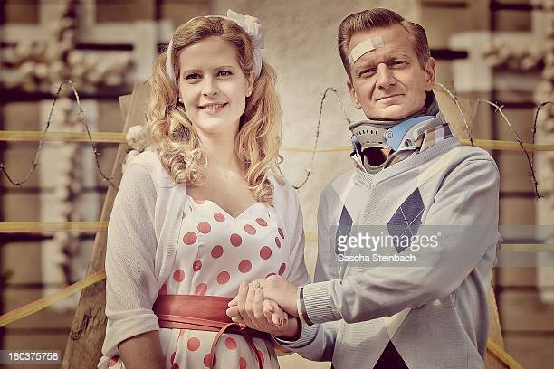 Actors Diana Amft and Michael Kessler pose during a photocall on set of 'Die Vampirschwestern 2' at Haus Tepes on September 12 2013 in Herne Germany