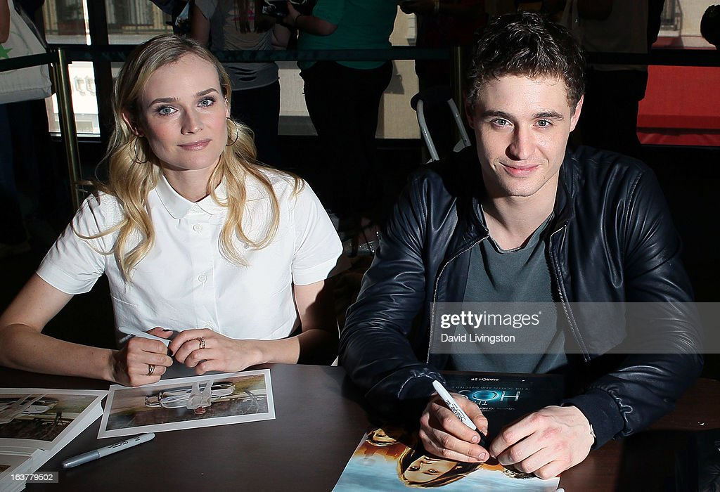 Actors Diane Kruger (L) and Max Irons attend a signing for Stephenie Meyer's book 'The Host' at Barnes & Noble bookstore at The Grove on March 15, 2013 in Los Angeles, California.