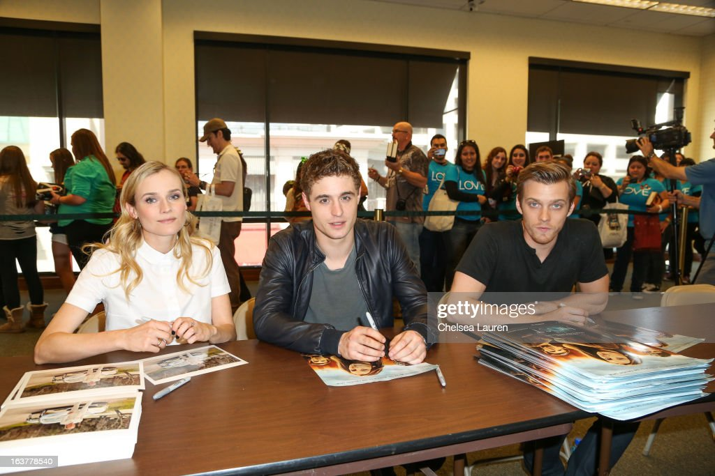 Actors Diane Kruger, Max Irons and Jake Abel sign autographs for fans at the celebration of the film release of 'The Host' at Barnes & Noble bookstore at The Grove on March 15, 2013 in Los Angeles, California.