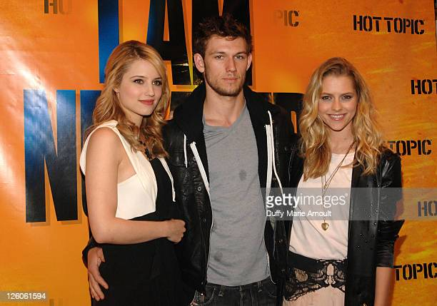 Actors Dianna Agron Alex Pettyfer and Teresa Palmer pose at Hot Topic on February 12 2011 in Hollywood California
