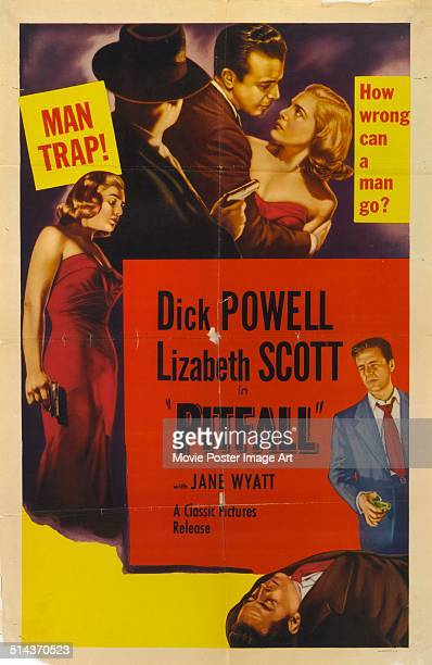 Actors Dick Powell and Lizabeth Scott appear on a poster for the movie 'Pitfall' with the tagline 'Man Trap' 1948