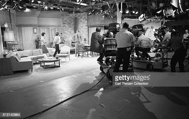 Actors Dick Van Dyke Mary Tyler Moore and Ann Morgan Guilbert in rehearsal for The Dick Van Dyke Show on December 2 1963 in Los Angeles California
