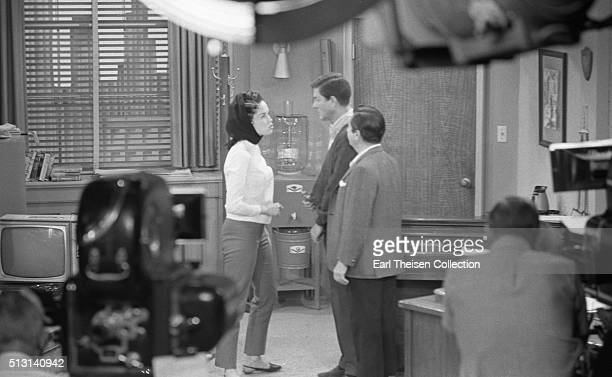 Actors Dick Van Dyke Morey Amsterdam and actress Mary Tyler Moore in rehearsal for The Dick Van Dyke Show on December 2 1963 in Los Angeles California