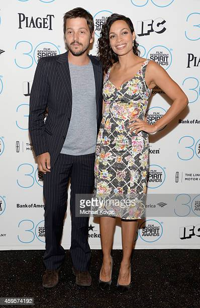Actors Diego Luna and Rosario Dawson wearing Piaget Rose Dentelle earrings attend the 30th Film Independent Spirit Awards Nominations Press...