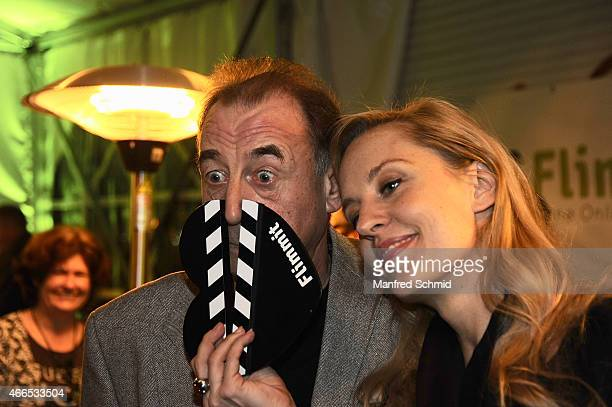 Actors Dietrich Siegl and Lilian Klebow pose for a photograph during the Flimmit launch party at Summerstage on March 16 2015 in Vienna Austria