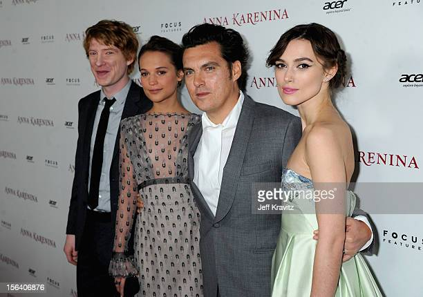 Actors Domhnall Gleeson and Alicia Vikander director Joe Wright and actress Keira Knightley attend the premiere of Focus Features' 'Anna Karenina'...