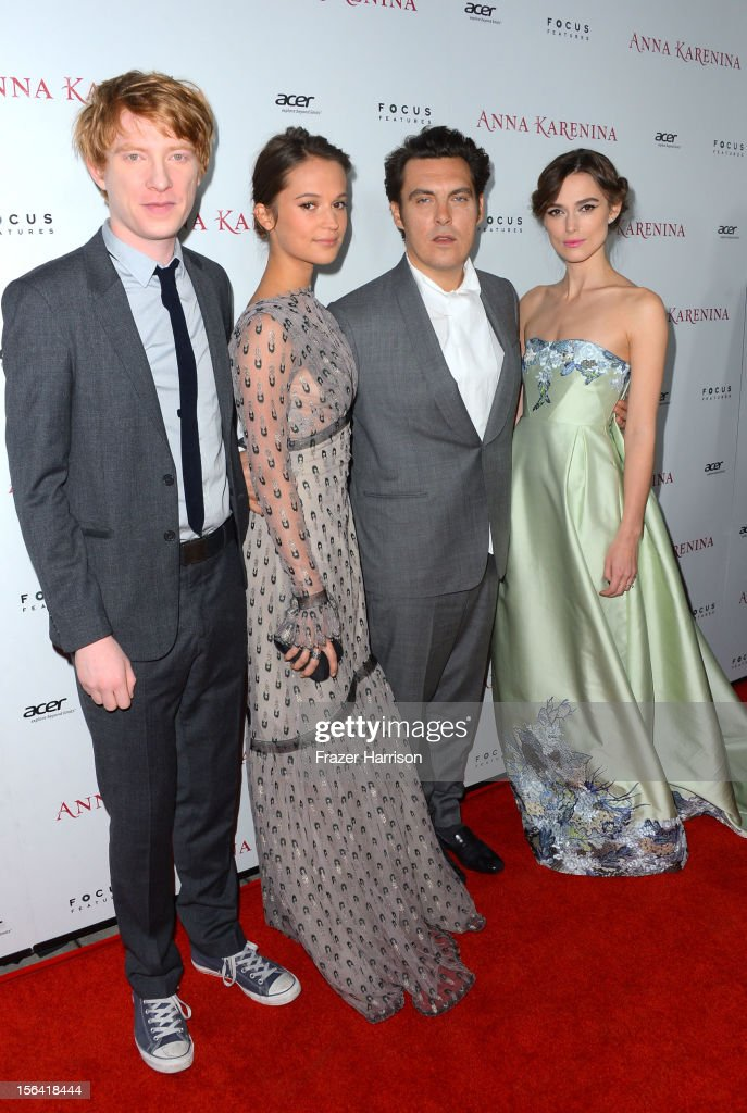 Actors <a gi-track='captionPersonalityLinkClicked' href=/galleries/search?phrase=Domhnall+Gleeson&family=editorial&specificpeople=653261 ng-click='$event.stopPropagation()'>Domhnall Gleeson</a> and <a gi-track='captionPersonalityLinkClicked' href=/galleries/search?phrase=Alicia+Vikander&family=editorial&specificpeople=7246025 ng-click='$event.stopPropagation()'>Alicia Vikander</a>, director <a gi-track='captionPersonalityLinkClicked' href=/galleries/search?phrase=Joe+Wright+-+Director&family=editorial&specificpeople=771298 ng-click='$event.stopPropagation()'>Joe Wright</a>, and actress <a gi-track='captionPersonalityLinkClicked' href=/galleries/search?phrase=Keira+Knightley&family=editorial&specificpeople=202053 ng-click='$event.stopPropagation()'>Keira Knightley</a> attend the premiere of Focus Features' 'Anna Karenina' held at ArcLight Cinemas on November 14, 2012 in Hollywood, California.