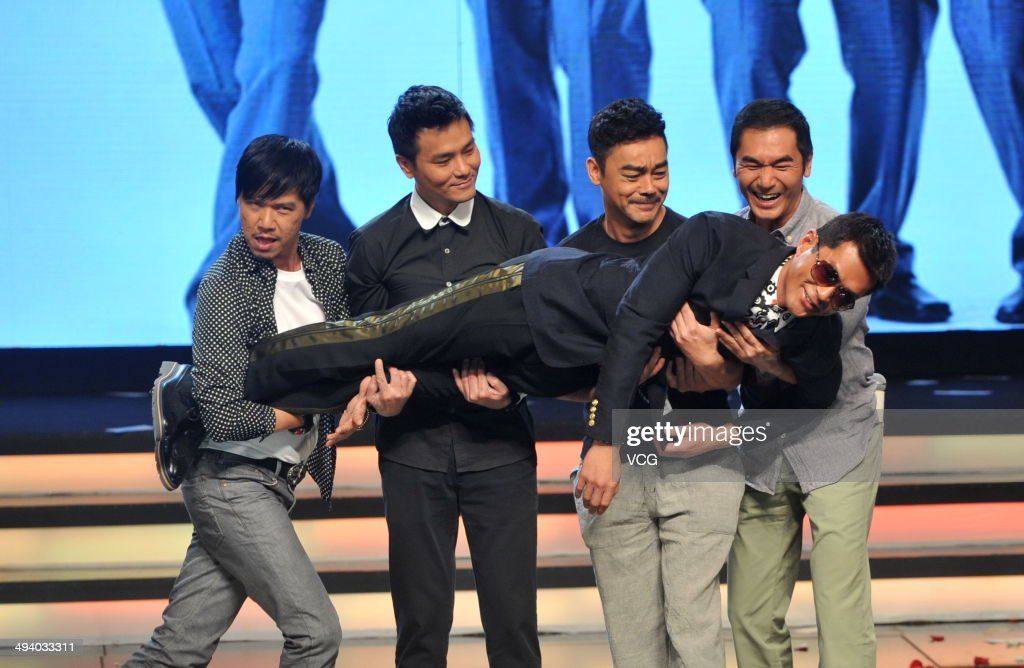 Actors Dominic Lam, Lam Ka Tung, Lau Ching-Wan and Alex Fong hold Louis Koo during 'Overheard 3' premiere at Tsinghua University on May 27, 2014 in Beijing, China.