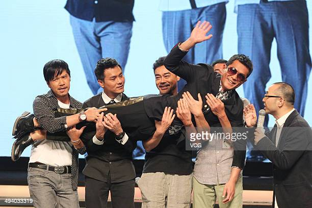 Actors Dominic Lam Lam Ka Tung Lau ChingWan and Alex Fong hold Louis Koo during 'Overheard 3' premiere at Tsinghua University on May 27 2014 in...