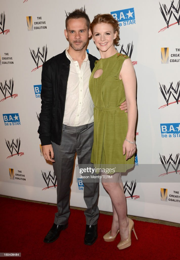 Actors <a gi-track='captionPersonalityLinkClicked' href=/galleries/search?phrase=Dominic+Monaghan&family=editorial&specificpeople=209279 ng-click='$event.stopPropagation()'>Dominic Monaghan</a> (L) and <a gi-track='captionPersonalityLinkClicked' href=/galleries/search?phrase=Ashley+Bell&family=editorial&specificpeople=3090917 ng-click='$event.stopPropagation()'>Ashley Bell</a> attend the WWE SummerSlam VIP Kick-Off Party at Beverly Hills Hotel on August 16, 2012 in Beverly Hills, California.