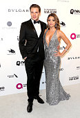 Actors Dominic Sherwood and Sarah Hyland attend the 24th Annual Elton John AIDS Foundation's Oscar Viewing Party on February 28 2016 in West...